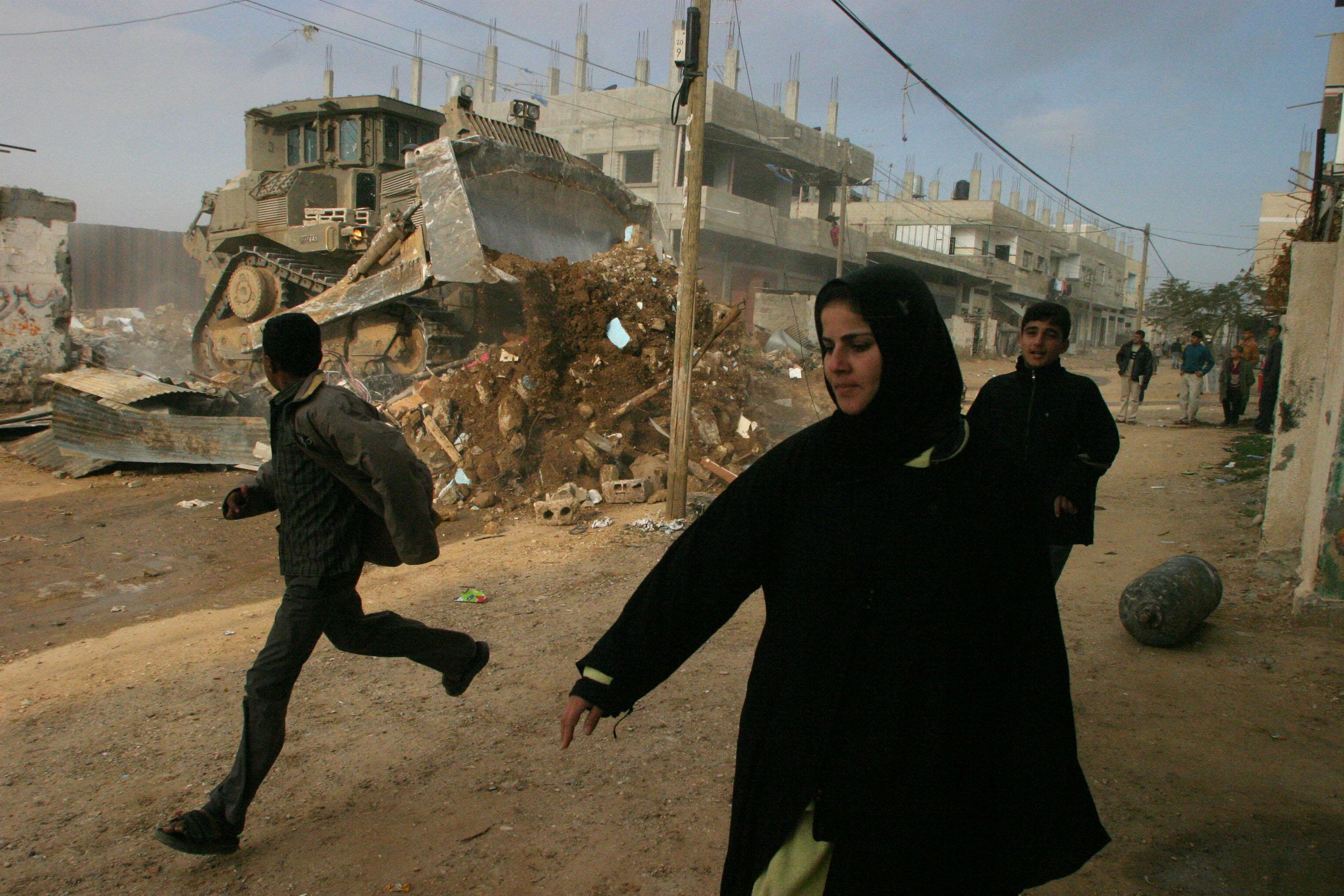 https://www.peacenotprofit.org/activistimages/gallery/Armored%20Bulldozer%20Destroys%20Palestinian%20Home.jpg